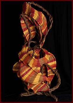 Dancing is a freestanding woven sculpture by master basket weaver Tina Puckett of Winsted, CT