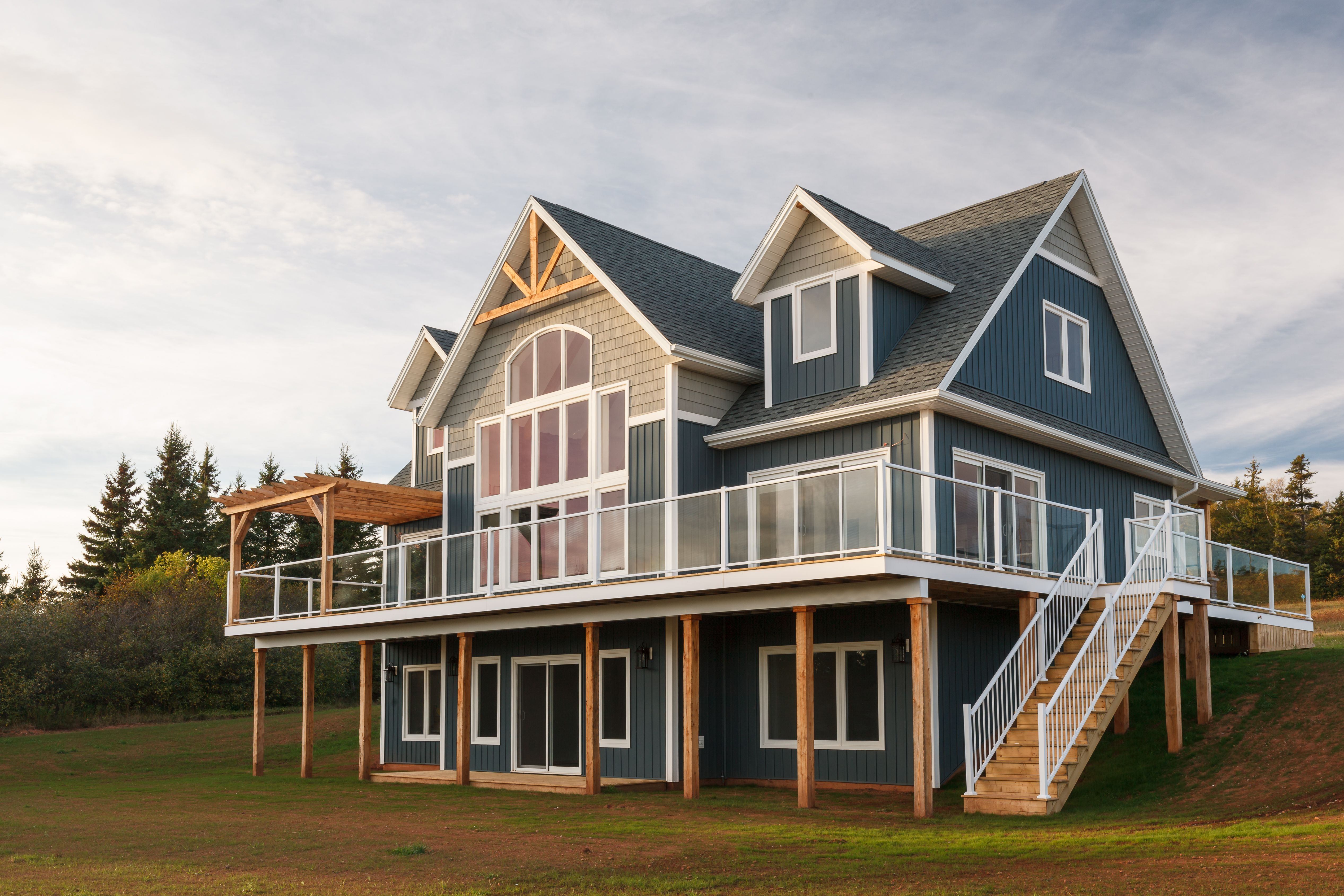 Gorgeous Home Featuring Royal Woodland Board Batten Siding In Heritage Blue Portsmouth Double House Exterior House Designs Exterior Exterior Color Palette