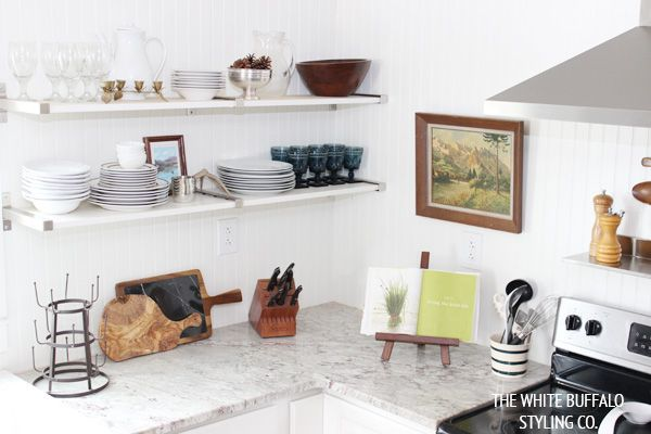 White Buffalo Styling Co.-using an oil painting in the kitchen, genius!