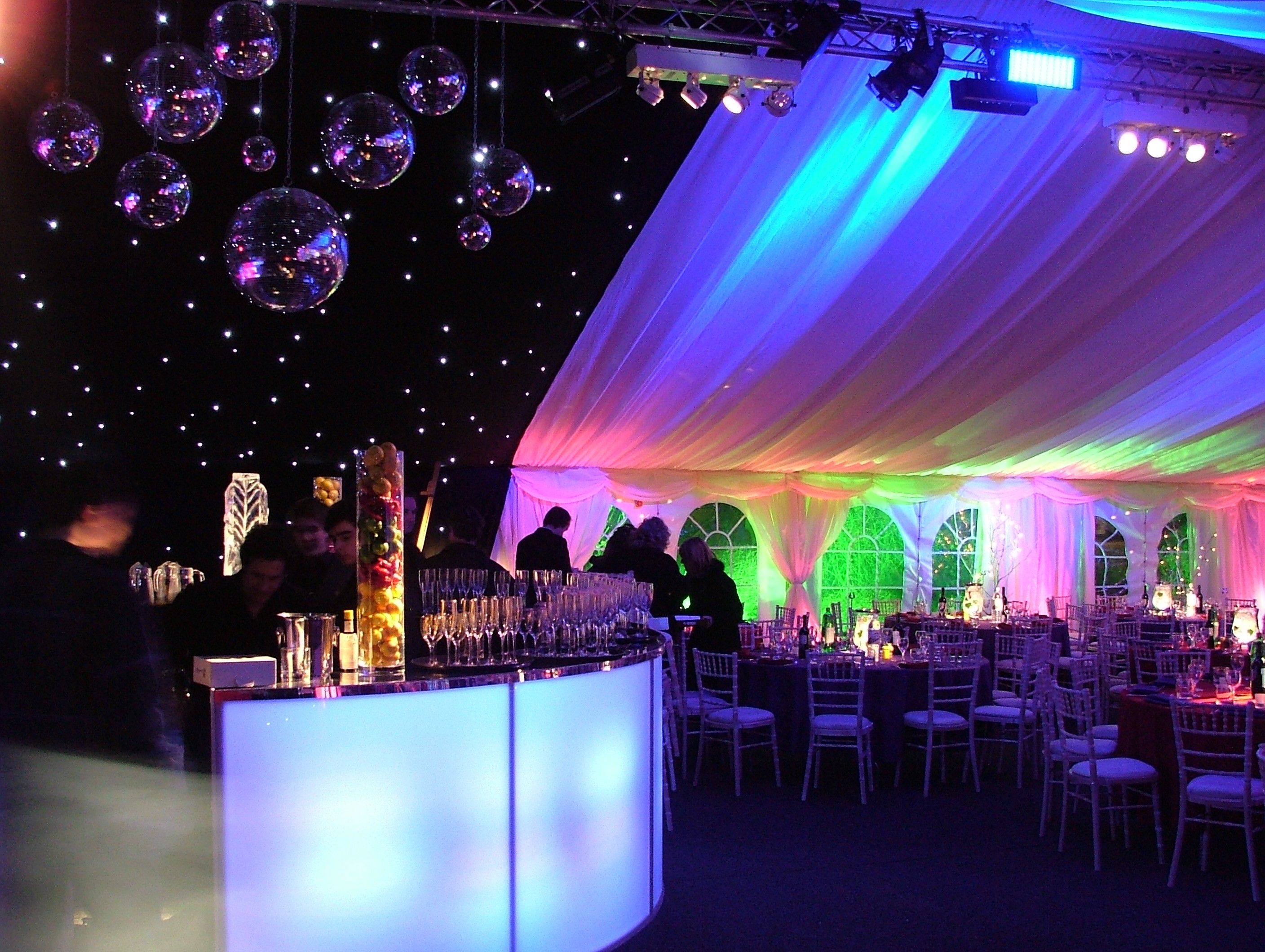 Setting the party scene with black starcloth and disco balls in a ...
