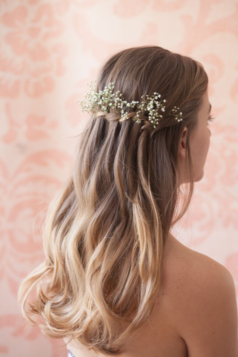 a waterfall braid with flowers in it would really look nice