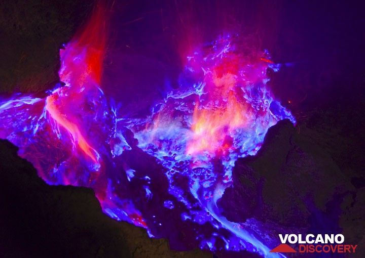Blue Flames And Red Sparks Are Visible Photo Andi Rosadi Ijen - Incredible neon blue lava flames erupt volcano
