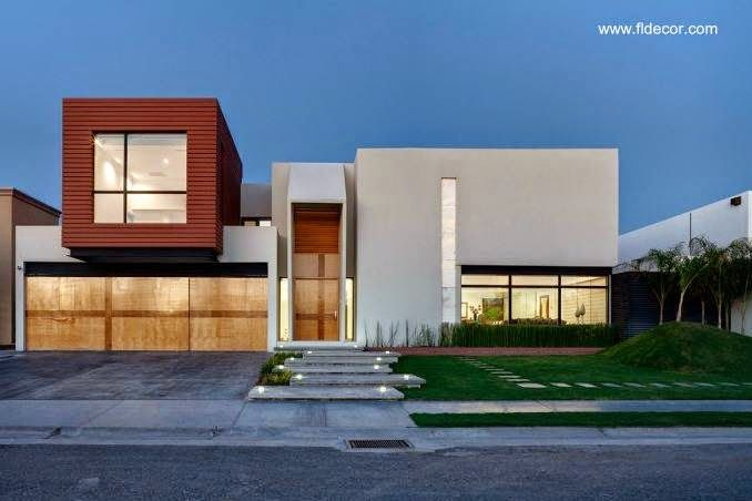 Fachada contemporánea de residencia formada por volúmenes fachadas - fachadas contemporaneas
