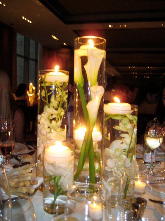 Clear cylinder vases for submerged flowers centerpiece