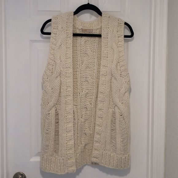 Michael Kors Sweater Vest Beautiful winter white Michael Kors Sweater Vest. Cable knit. Great for those spring or fall outfits! In great condition. Michael Kors Sweaters