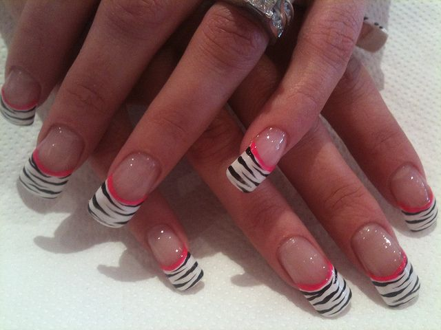 White tips with black zebra and pink flower nail art | Flower nail ...