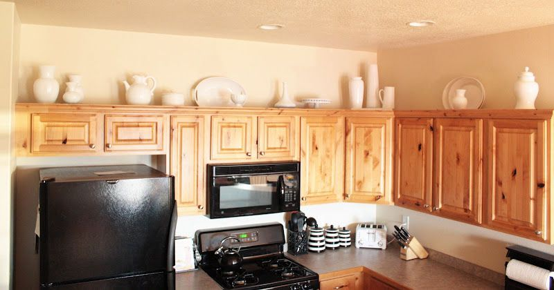 milk glass (or spray painted pieces?) on top of cabinets. | Home ...