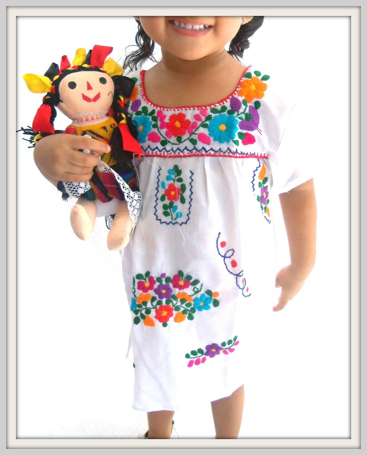 Nubes y Flowers Ethnic Handmade Embroidered Mexican White Baby Tunic Dress.  $35.00, via Etsy