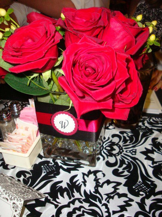 Red rose centerpieces candles wedding roses