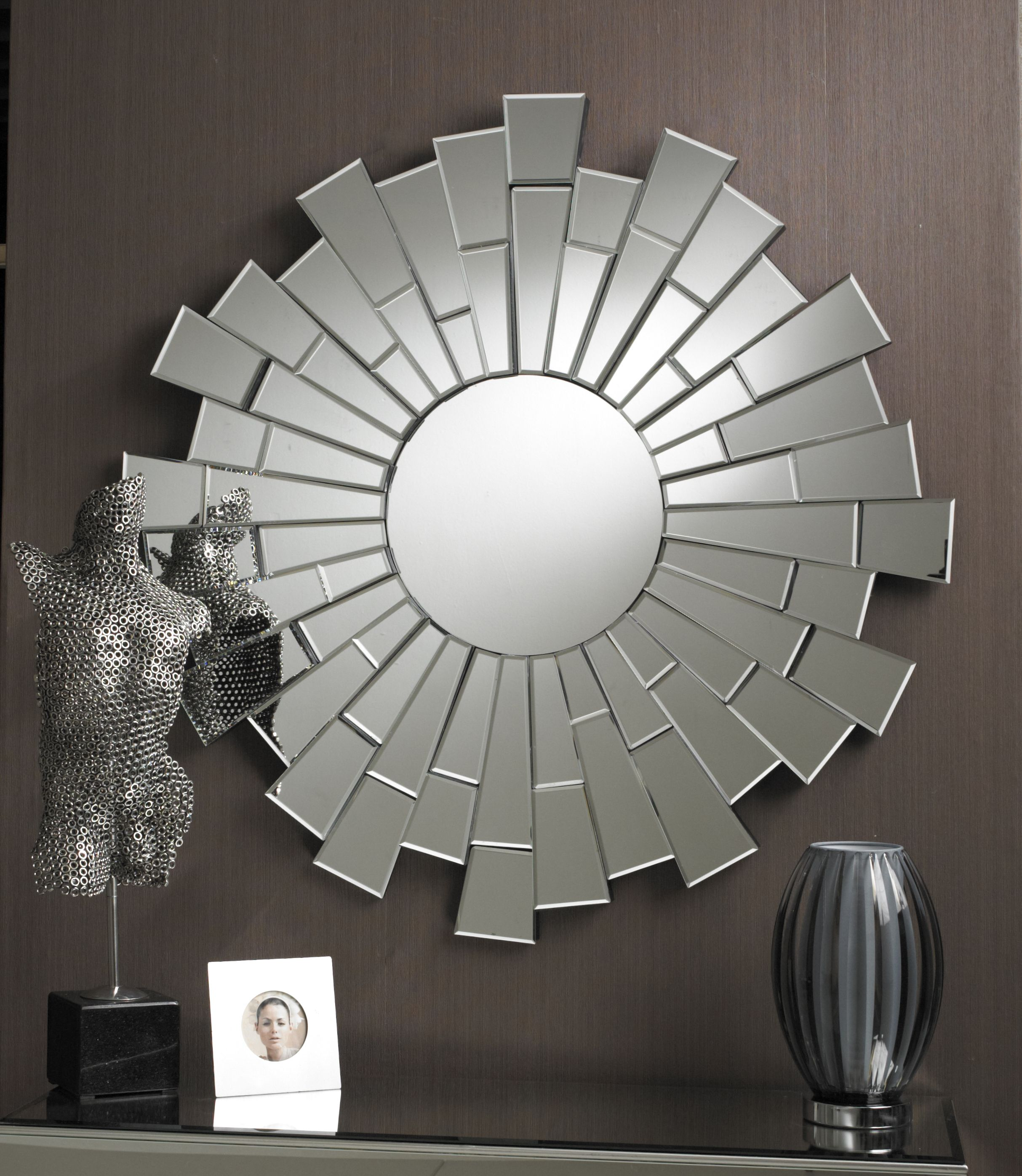 This dramatic mirror has a small circle at its centre; there are ... - This dramatic mirror has a small circle at its centre; there are many  multifacet sections