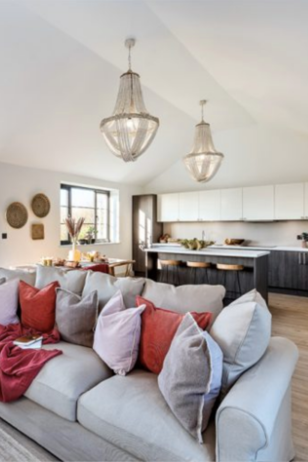 Discover the ideas behind Biophilic design with designer Angela Cheung. Natural colours, textures and materials are seen in the living room, bedroom and kitchen of this new build development #biophilicdesign #interiors #interiordesign #homedecor #decocafe