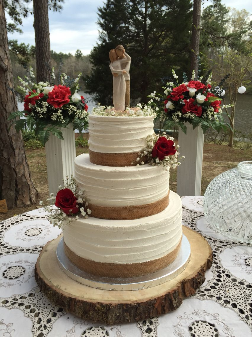 tier rustic buttercream wedding cake with burlap and red roses
