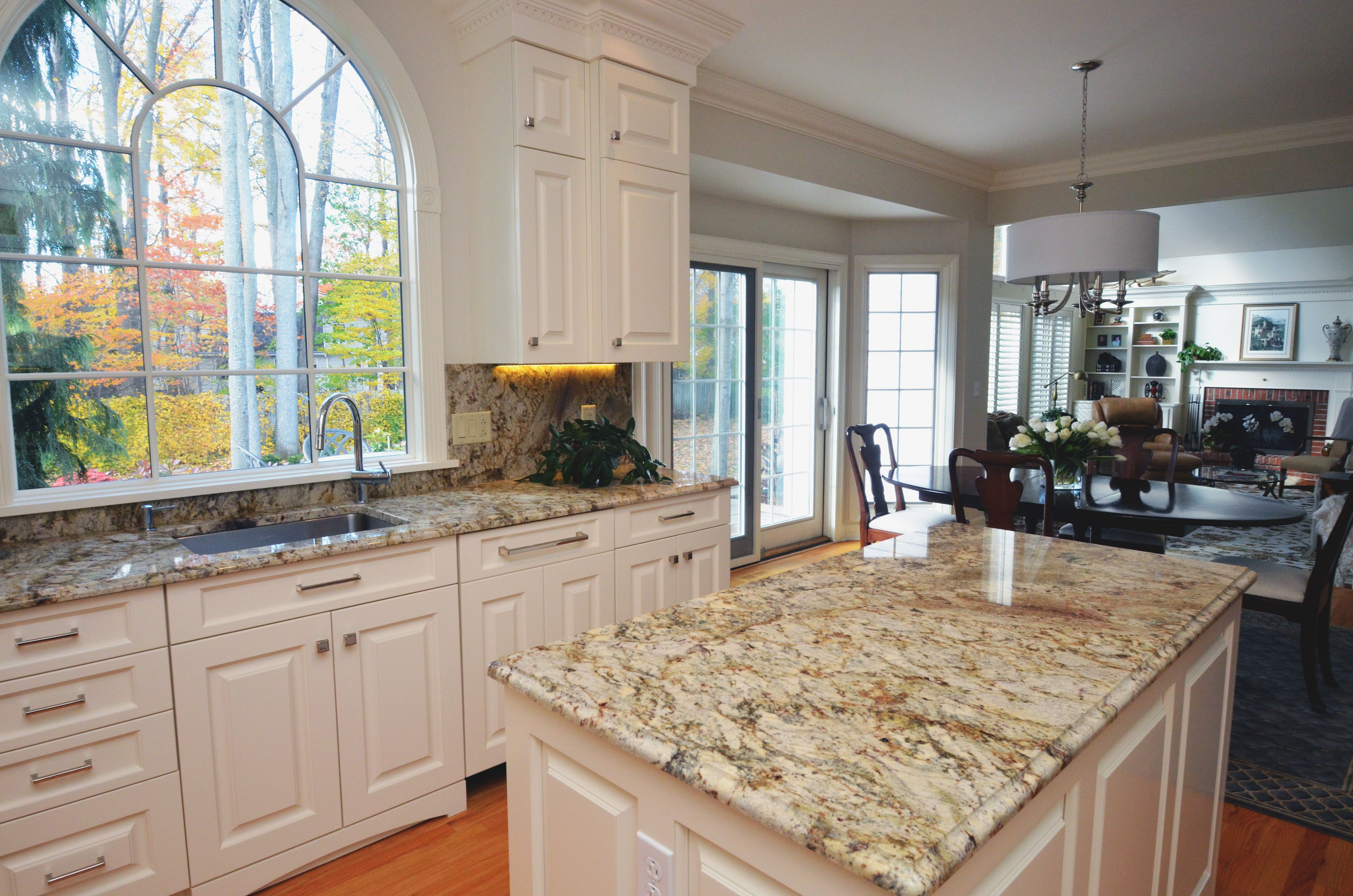 Traditional style kitchen with granite countertops and a full
