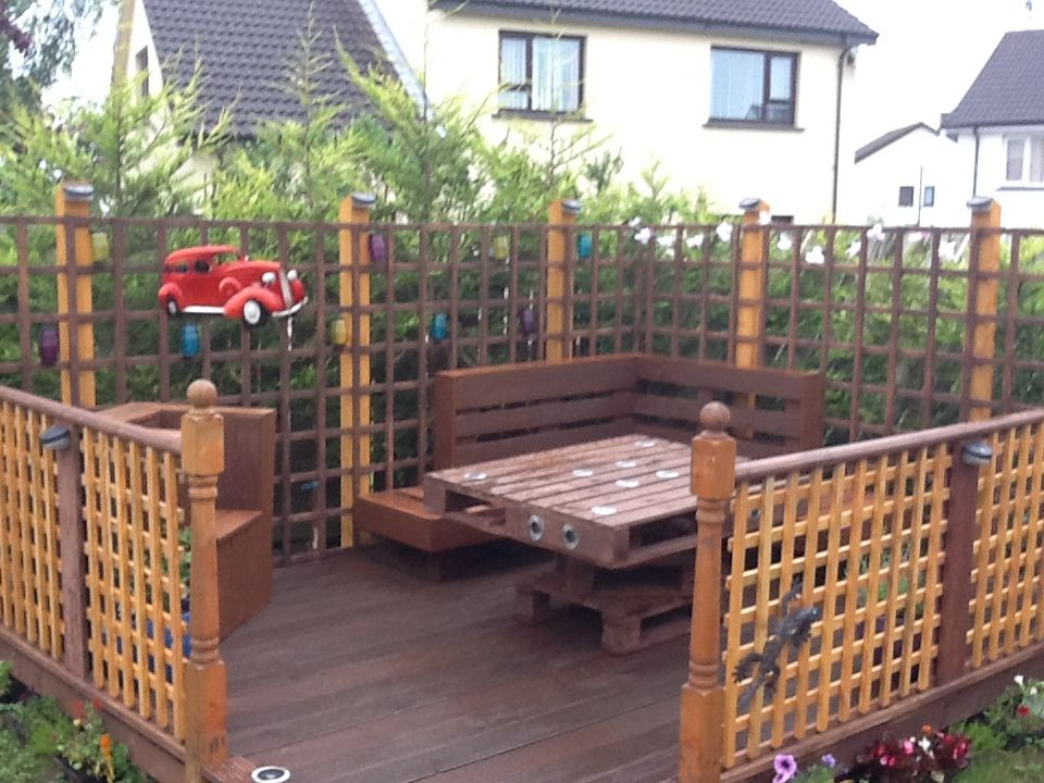 Decking table seating and fencing all made from for Reclaimed wood decking