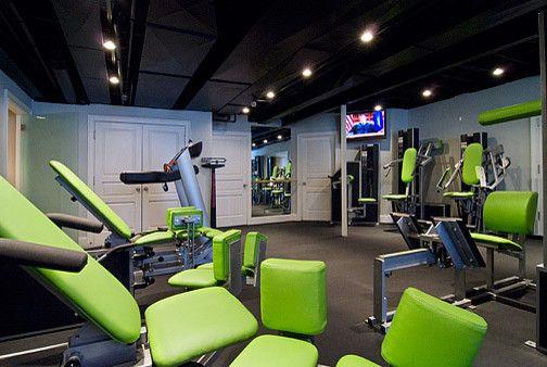 Zumba green lighting black ceiling home gym
