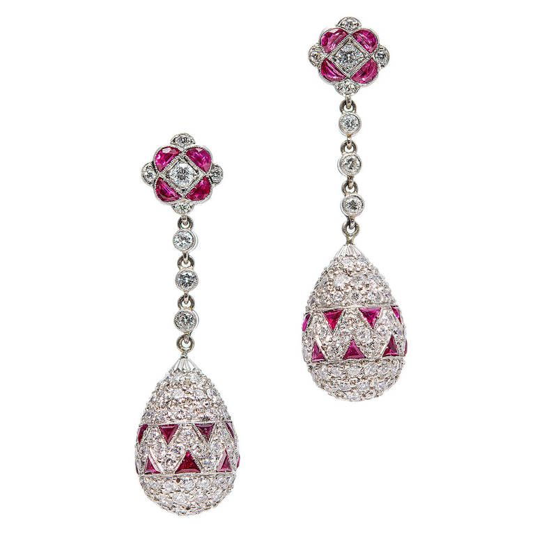 Ruby Diamond Platinum Dangle Earrings. Platinum Fine Ruby Dangle Earrings.This is a very rare world class jewel. Solid Platinum 3 dimensional drop pendant earrings. Completely covered with extra fine bright red natural rubies and fine white diamonds. Looks great on the ear. Art Deco.