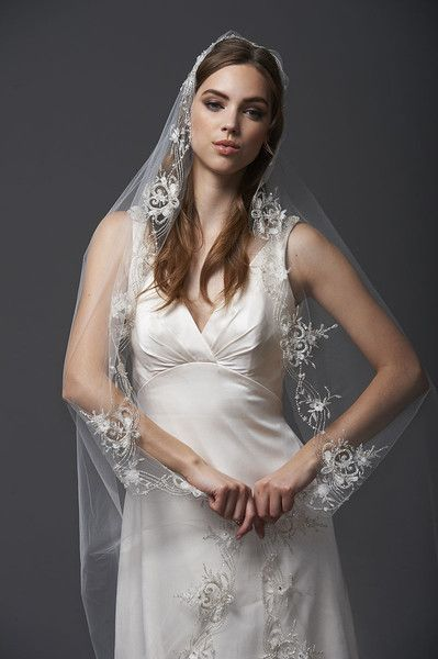 """Blossom Veils & Accessories VITAL-0851         108"""" veil intricately trimmed with handbeaded swarovski crystals and delicate silk appliques. All veils are customizable to any length in a variety of standard colors."""