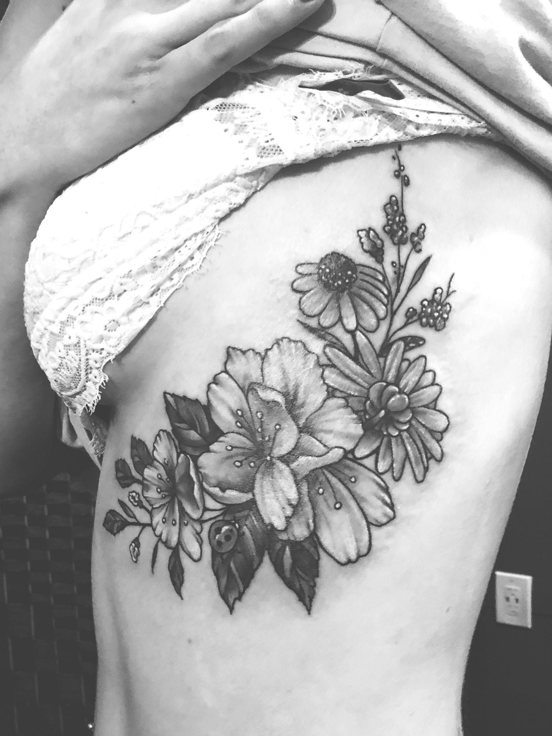 Gladiolus Flower tattoo black and white rib tattoo