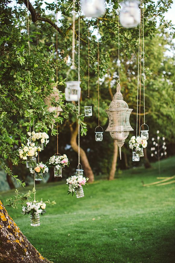 35 totally brilliant garden wedding decoration ideas hanging outdoor wedding rustic hanging decor using glass jars tin cans and glass jars are easy to collect we could make these over summer junglespirit Image collections