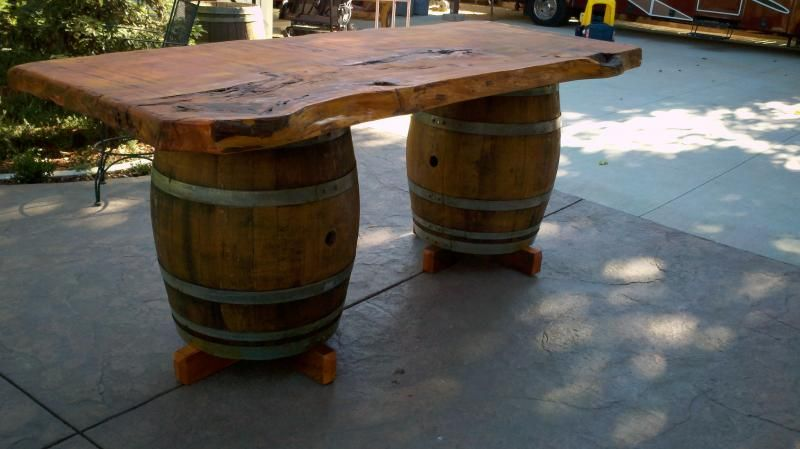 A Rustic Vintage Looking Dining Table With Wine Barrel Legs