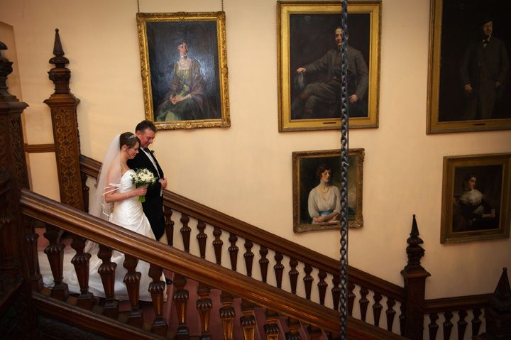 Bride and her father descending the Grand Staircase at Arley Hall.