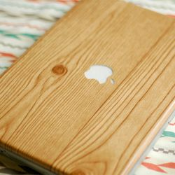 laptop covered with wood grain contact paper