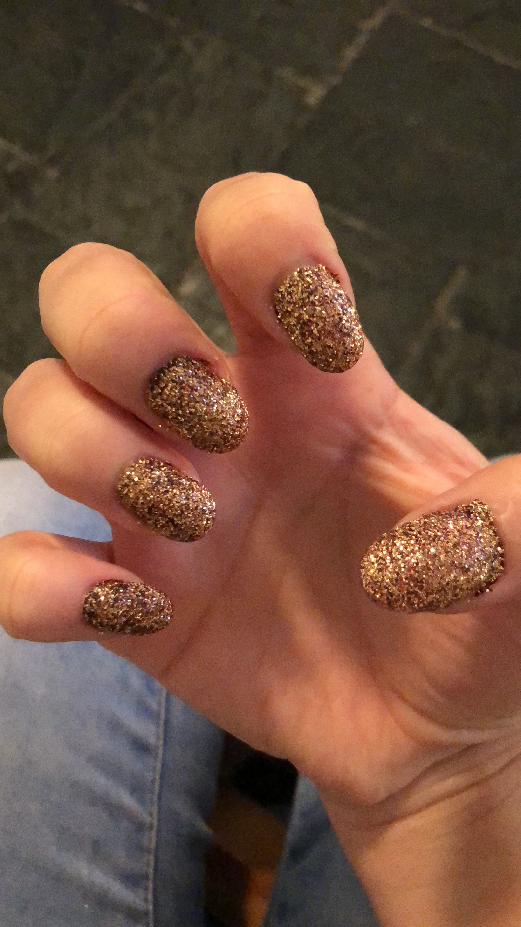 Glitter nails, dark red nail polish as an under layer followed by ...