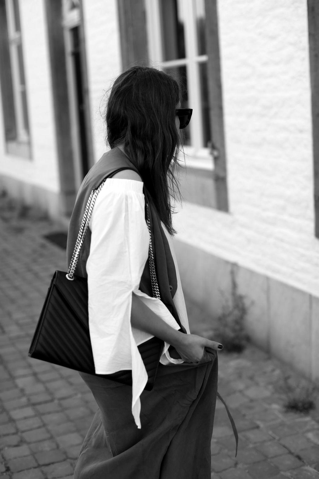 KHAKI SILK | Fiona from thedashingrider.com wears a white off-shoulder blouse, a olive Belstaff vest, a Saint Laurent leather bag and Céline Caty sunglasses | Petite Blogger | Style Blogger | Outfit