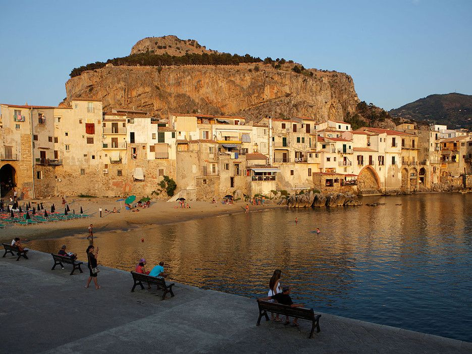 Wedged between mountains and coastline, just an hour's drive east of Palermo, the idyllic town of Cefalu is tiny but popular—especially among sun-seekers from other parts of Italy. Besides gorgeous beaches, Cefalu also offers great Sicilian restaurants and a hip nightlife scene, particularly in the summer months when its population triples.