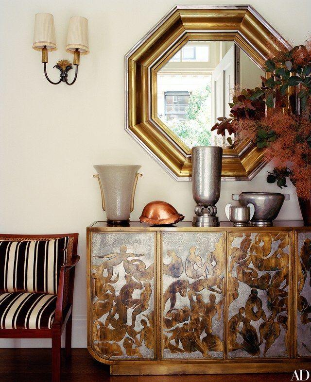 The foyer's Jansen mirror is from Bernd Goeckler Antiques.
