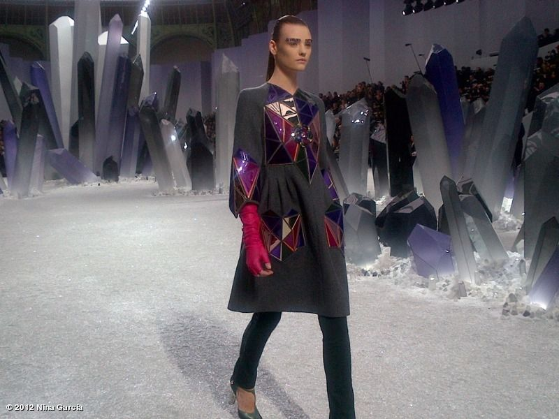 Adore the purple crystals background at the Chanel show.