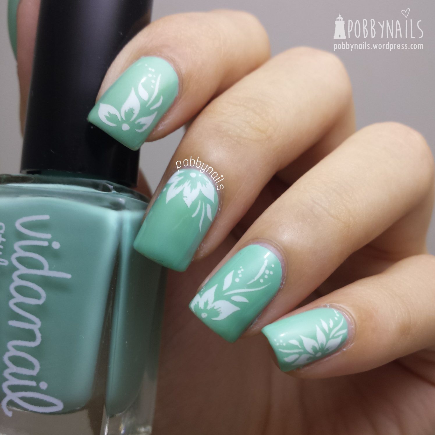 Water Decals Y003 over Emerald Green by Vidanail. Both available at @nailartsingapor . Use code POBBY during check outs to enjoy 10% off. :)  http://instagram.com/p/p33qS9Ben4/?modal=true