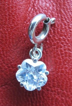Lovely flower charm crafted in fine sterling silver-a bit sparkle day to day:) See at http://www.greykajewellery.eu/shop/charms/sterling-silver-flower-charhttp://www.greykajewellery.eu/shop/charms/sterling-silver-flower-charm/m/