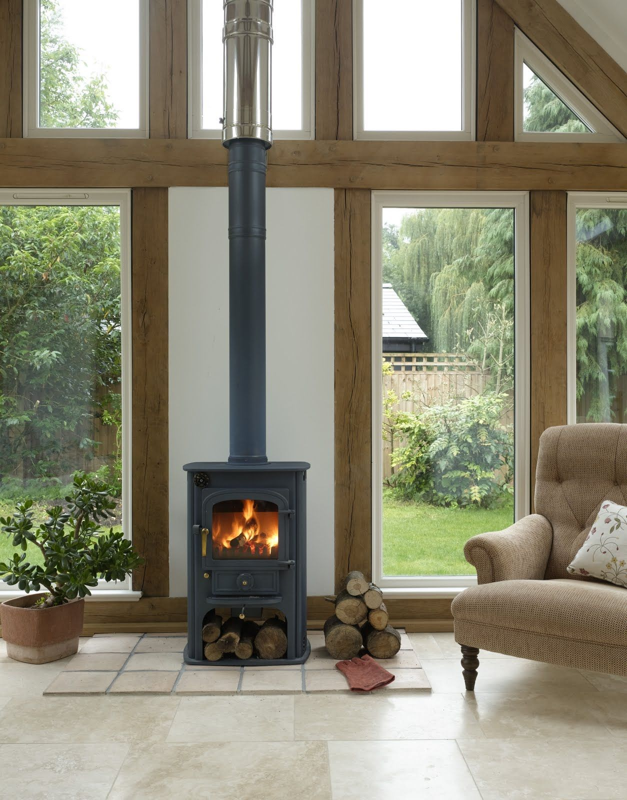 Log fire in glass wall winter log cabin chalet for Wooden garden rooms extensions
