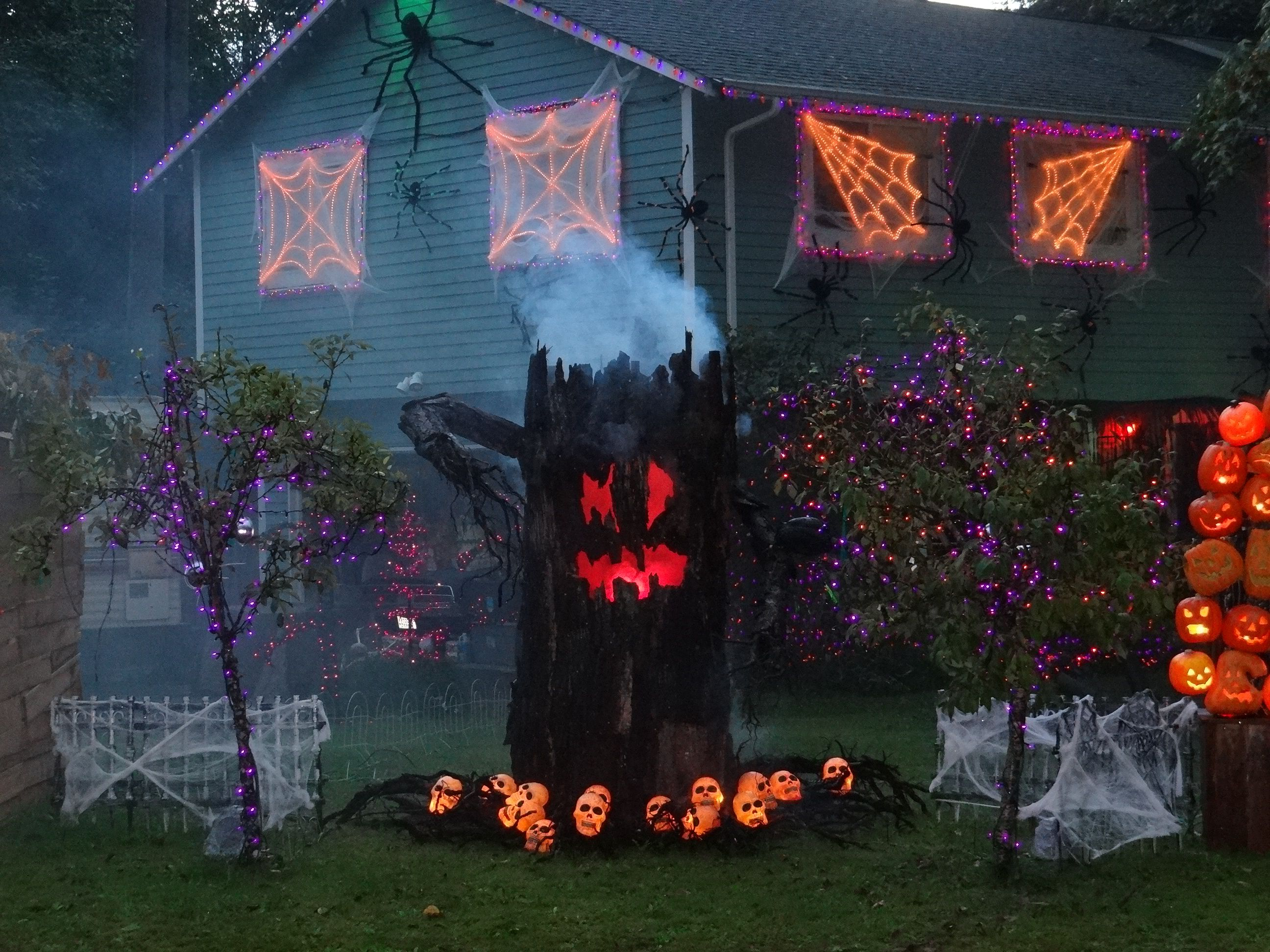 use rope lights to create a giant scary spider web halloween decorating with lights