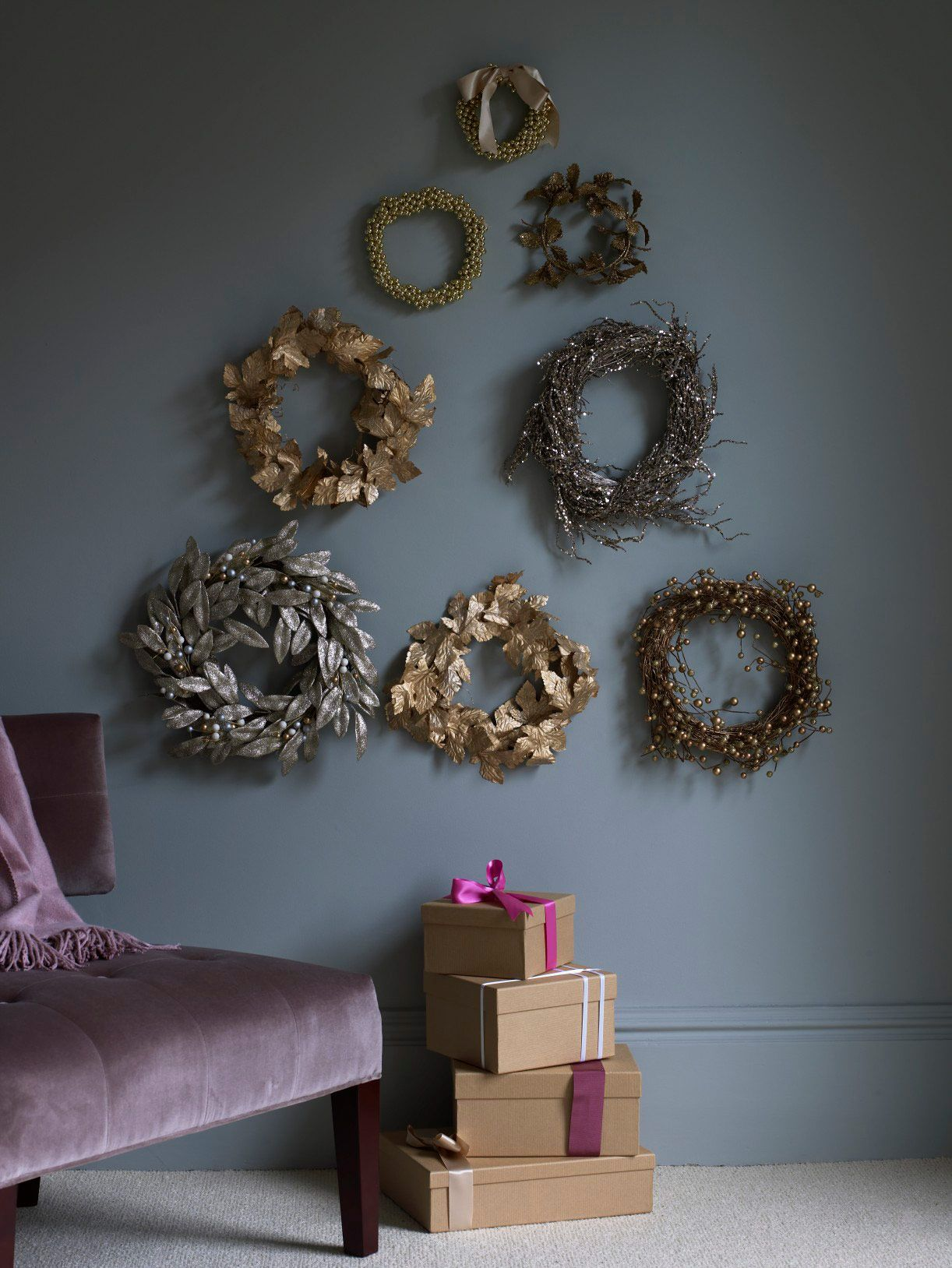 Garlands can be made into wreaths and arranged to resemble a Christmas tree. Homes & Gardens January 2011. Photographer Carolyn Barber. #Festive #ChristmasDecorations