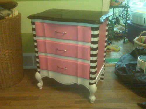 Using spray paint to refinish found furniture.