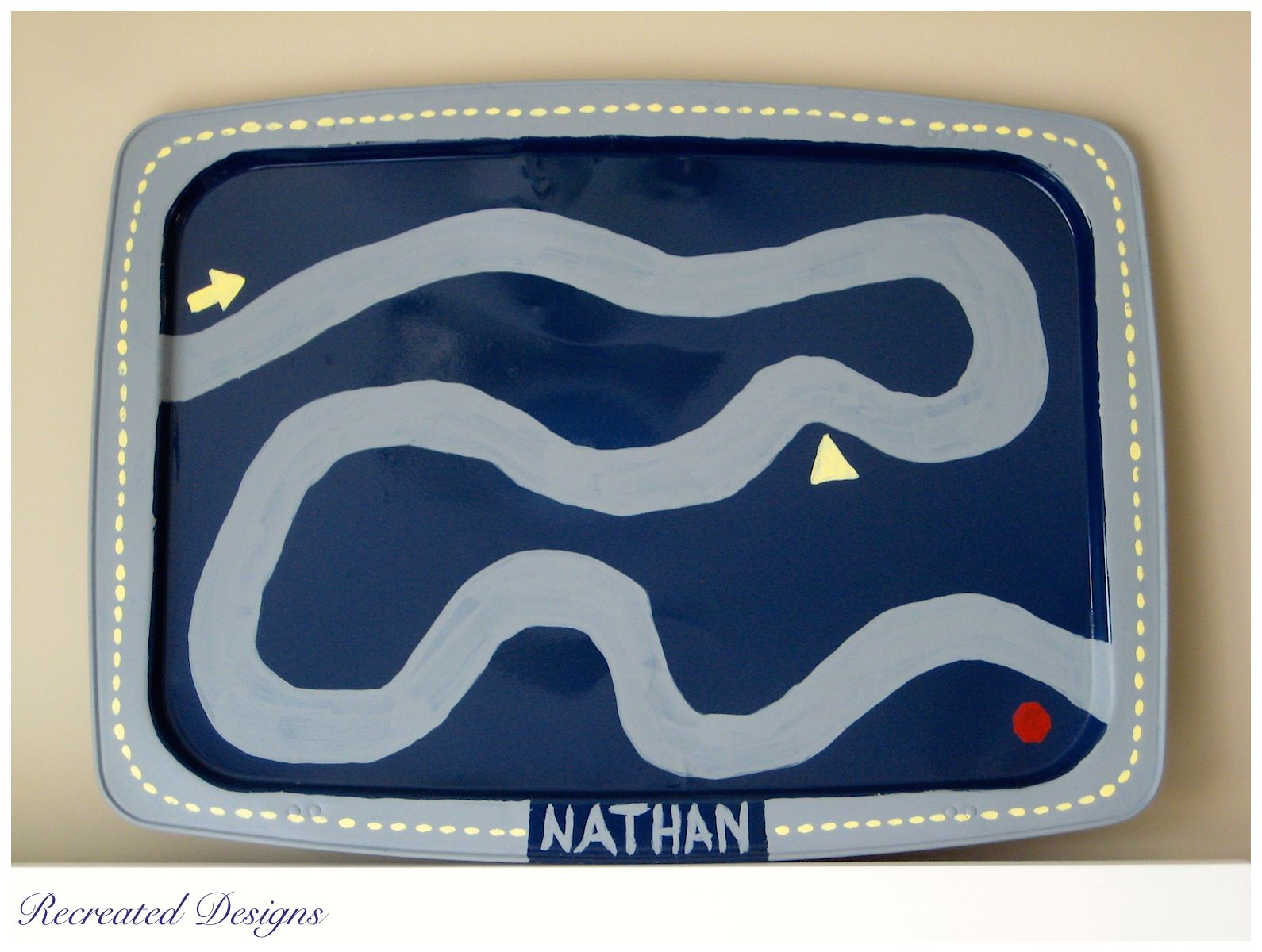 A vintage TV tray turned into a piece of art for the wall and a play mat for toy cars.   http://recreated-designs.blogspot.ca/2014/08/childhood-memories-of-tv-trays.html
