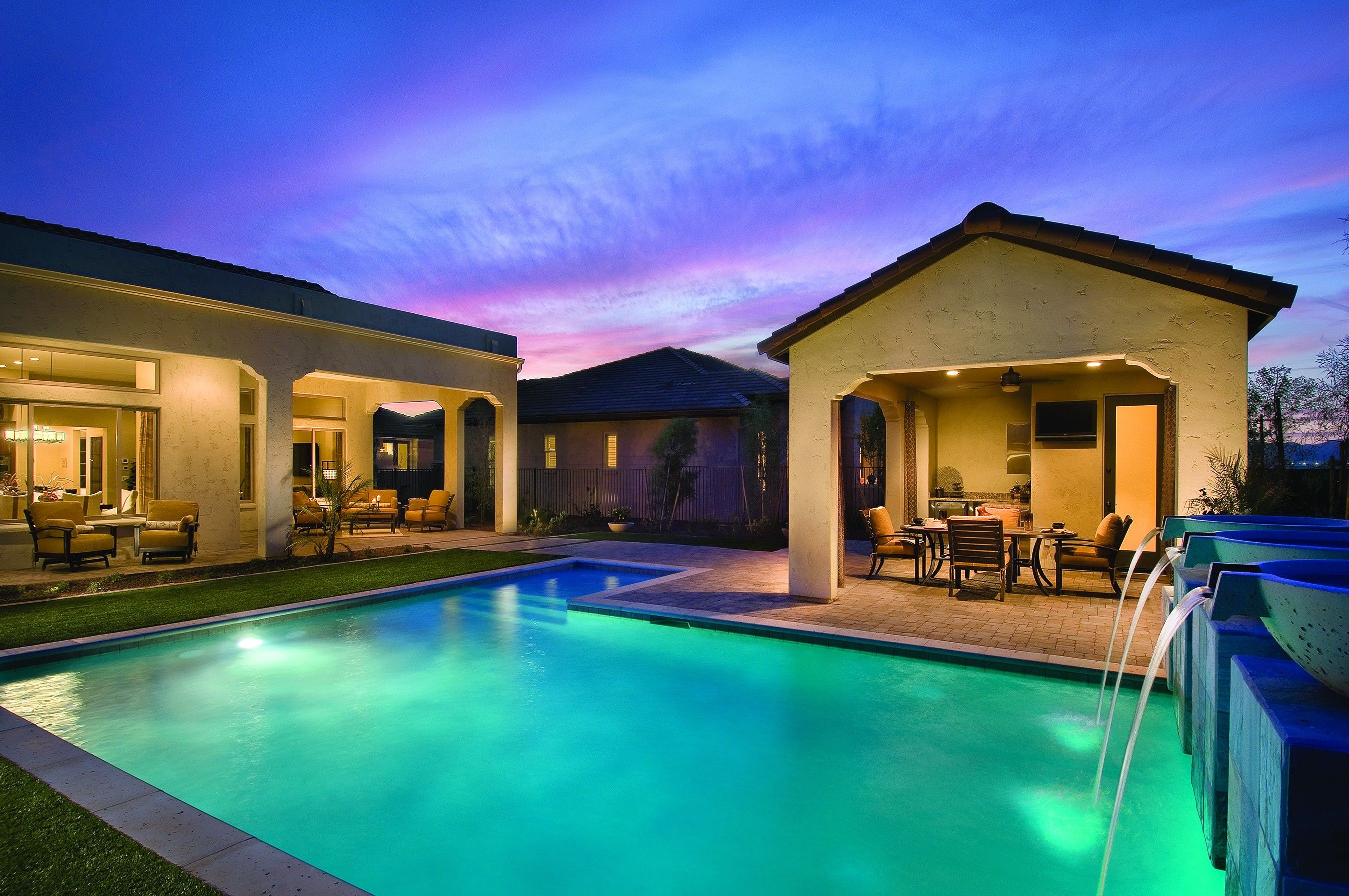 Covered patio Casita and relaxing pool Sonata model home at