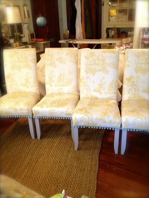 SheShe, The Home Magician: Upholstered dining room chairs in vintage yellow toile with aqua pompom fringe.