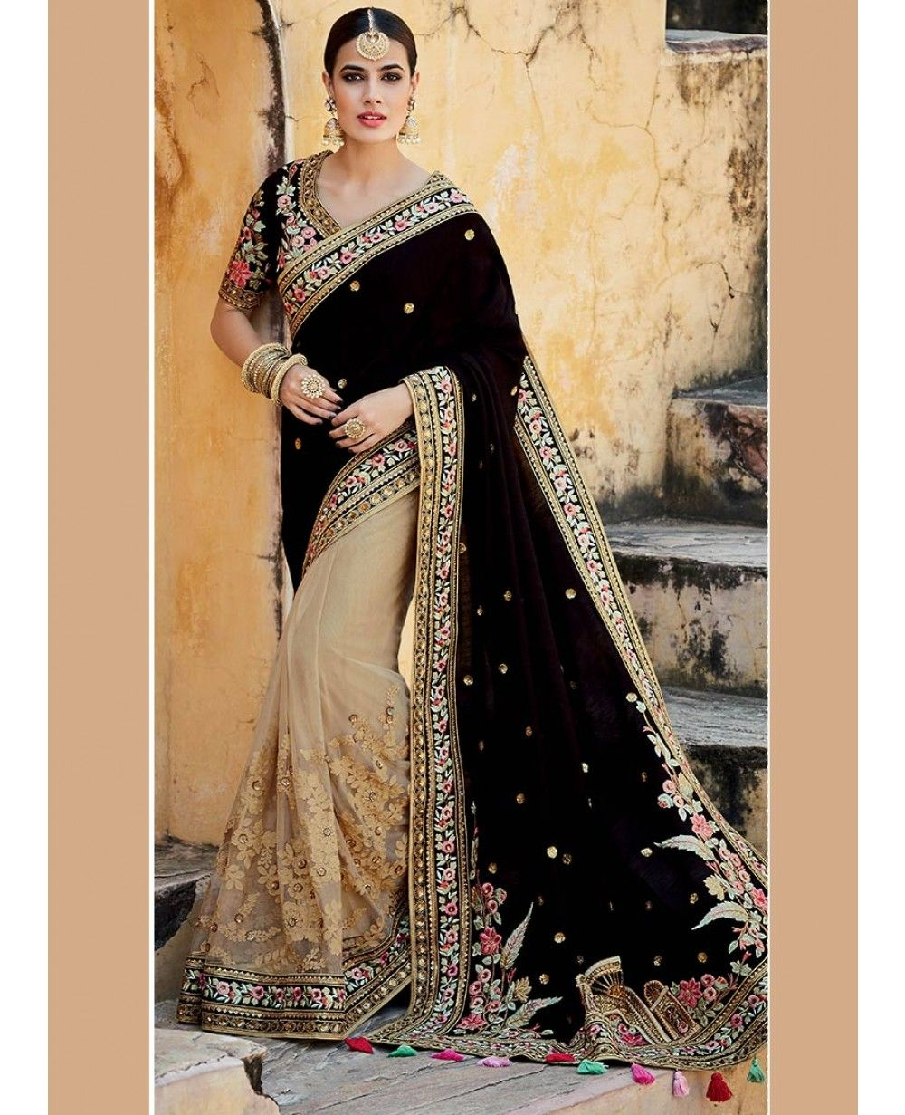 Beige and dark brown colour net and and tussar silk half and half saree with embroidered floral patterns with sequins work on the first half, sequins motifs on the second half of the saree and floral patterns on the border. Comes with matching blouse.