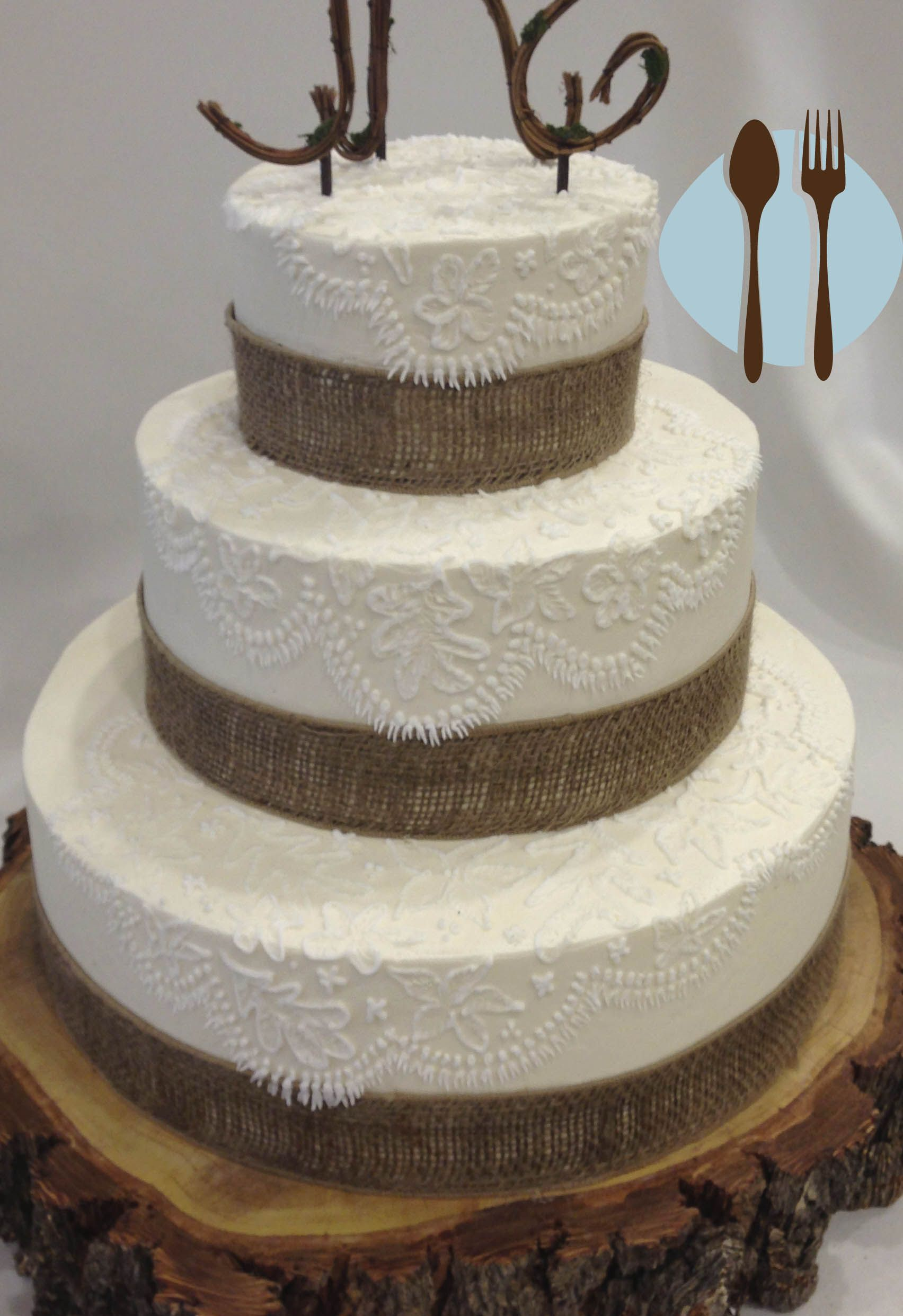 Burlap and lace country chic wedding cake on a log stand