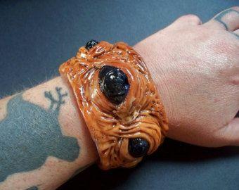 Hideous polymer clay fleshy eyeballs and gemstone pus bubbles cuff bracelet.  #jewelry