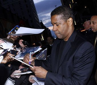 Celebrity of the Day: Denzel Washington signing silent auction items Charity Fundraising Packages