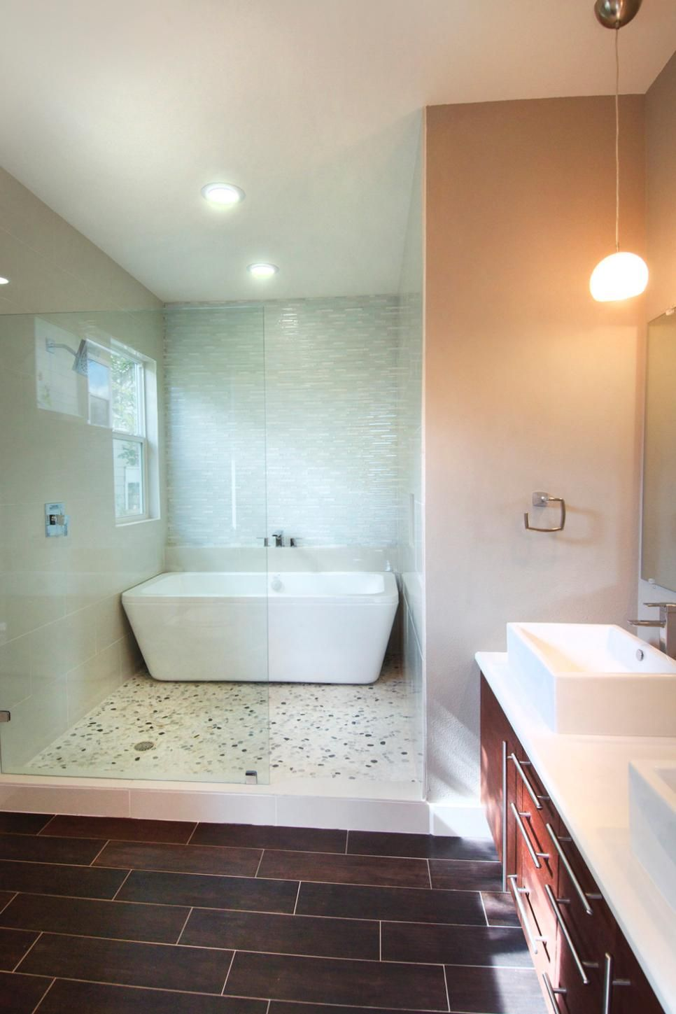 This contemporary bathroom features a spa like wet room for What s a wet room