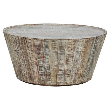Acacia Wood Coffee Table With A Tapered Silhouette And Weathered Lime Wash.  Product: Coffee