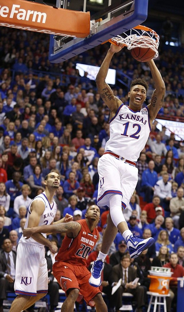 Kansas guard Kelly Oubre Jr. (12) delivers a dunk off a