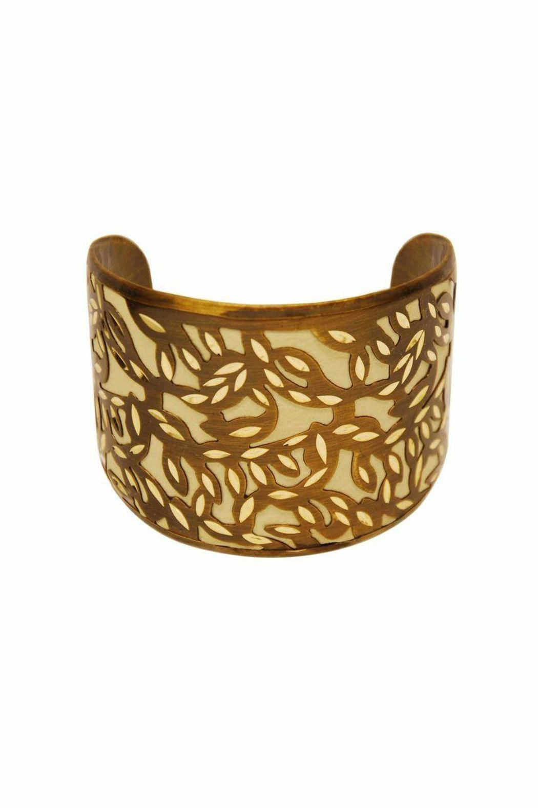 Neutral and serene; a cream toned background is encased by floral Moroccan inspired cut outs. Wear with the other cuffs from this collection for advanced style. One size fits most, base is adjustable.   Taza Cuff by Made It!. Accessories - Jewelry - Bracelets New Jersey