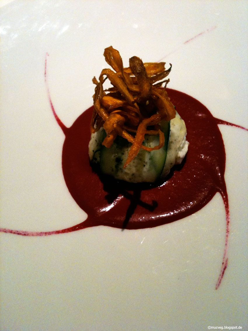 At Vegetaria: Zucchini stuffed with Cheese-Mixture on red beet sauce and topped with carrot-chips