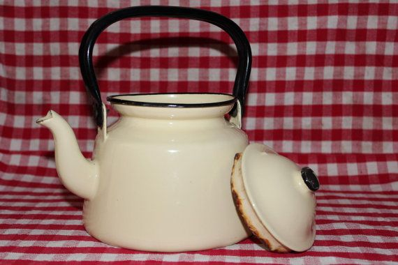 Vintage cream enamel kettle. In used condition with a few scratches and chips, but no cracks. There is some rust on the lid. Would make a great